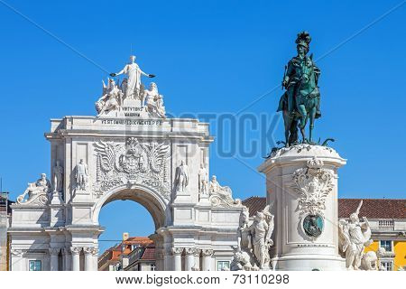 Close-up on the King Dom Jose I statue  and the iconic Triumphal Arch connecting the Augusta Street and the Praca do Comercio Square, aka Terreiro do Paco
