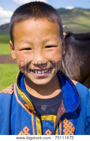 Mongolian boy with a beautiful smile.