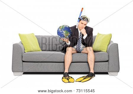 Sad businessman holding the earth and sitting on sofa isolated on white background. Earth image in public Domain and furnished by NASA