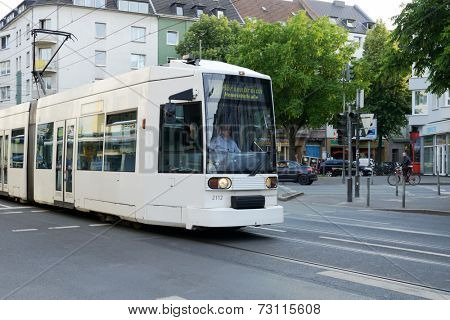 DUSSELDORF, GERMANY - JUNE 29, 2013: Modern tram on the Helmholtz street. The tramway network is operated by Rheinbahn AG and has eleven tram lines ran over 78.0 kilometres of route