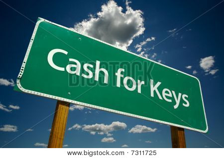 Cash For Keys Green Road Sign Over Clouds
