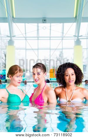 Women swimming in indoor public pool