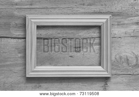 blank photo frame on old wooden gray wall