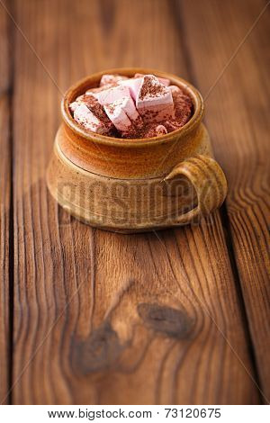 hot chocolat vintage mug, topping with marshmallow on textured wood