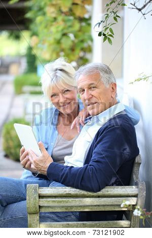 Senior couple websurfing on internet with tablet