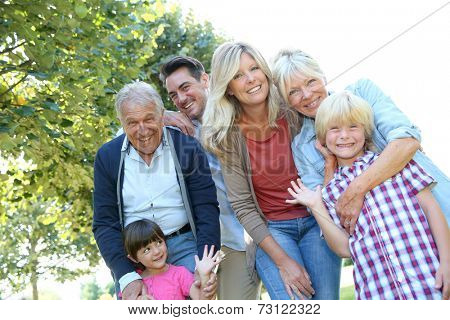 Happy 3 generation family in grandparents' backyard