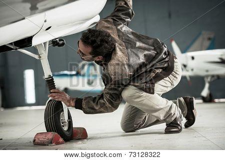 Pilot preparing his airplane