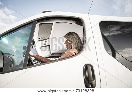 Portrait of a woman in her car