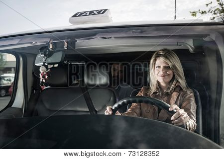 Female taxti driver with passenger