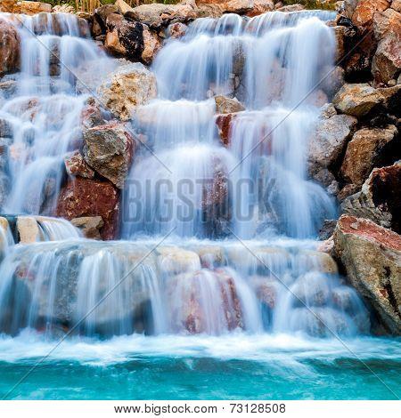 waterfall beautiful background of stone, water, moss.