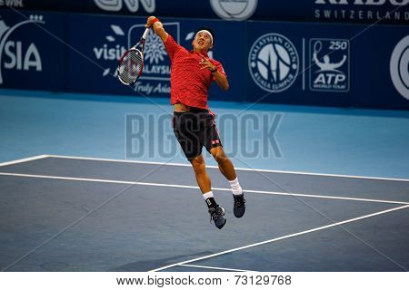 SEPTEMBER 26, 2014 - KUALA LUMPUR, MALAYSIA: Kei Nishikori of Japan smashes in his match at the Malaysian Open Tennis 2014. This event is an ATP sanctioned tournament.