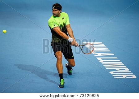 SEPTEMBER 26, 2014 - KUALA LUMPUR, MALAYSIA: Marinko Matosevic of Australia prepares for a backhand return in his match at the Malaysian Open Tennis 2014. This event is an ATP sanctioned tournament.