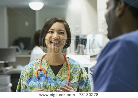 Female nurse talking to co-worker
