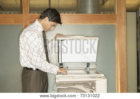 Businessman using copy machine