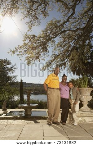 African American family hugging outdoors