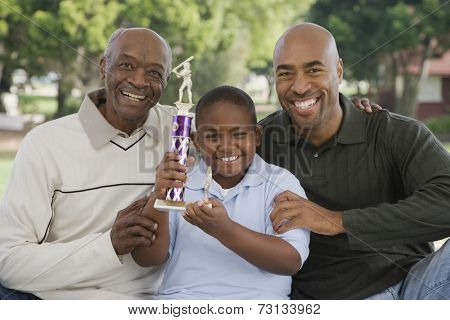 African American family with trophy outdoors