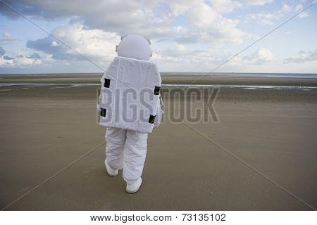 Astronaut walking on the beach