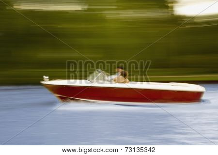 Blurred motion shot of motorboat