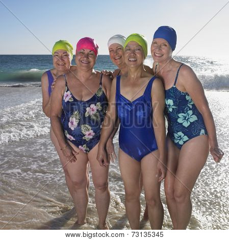Group of senior women in bathing suits at beach