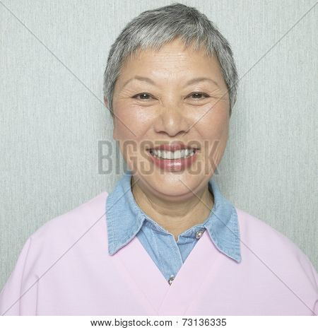 Close up of senior Asian woman smiling
