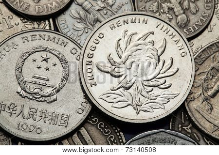 Coins of China. Chrysanthemum flower and the National emblem of China depicted in the Chinese one Yuan coins.