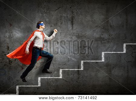 Young superhero walking up the stair case