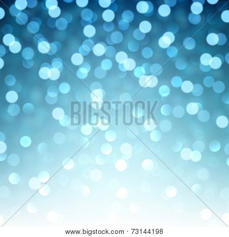 Blue defocused christmas background. Bright bokeh. Vector illustration.