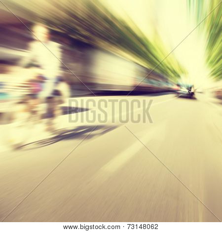 Motion blurred image of a city street scene.