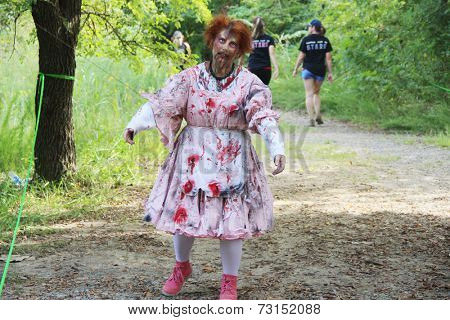 MUSKOGEE, OK - Sept. 13: A bloody female zombie waits for runners during the Castle Zombie Run at the Castle of Muskogee in Muskogee, OK on September 13, 2014.