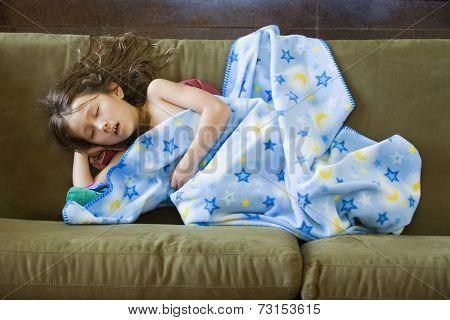 Asian girl sleeping on sofa