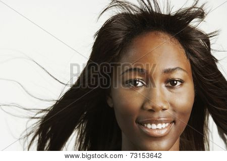 Close up of African woman with hair blowing
