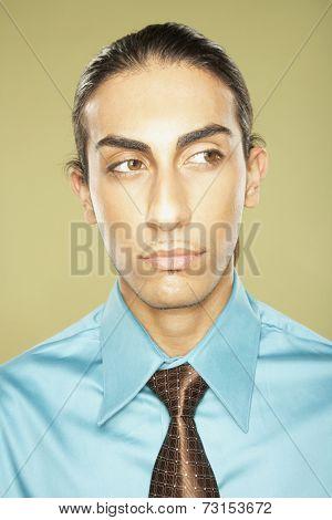 Middle Eastern businessman looking sideways