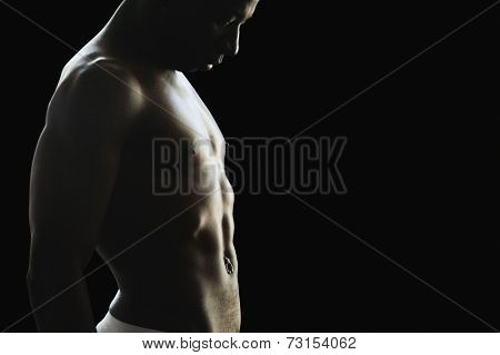 Studio shot of bare-chested African man