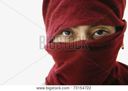 Pacific Islander man with scarf covering head and face