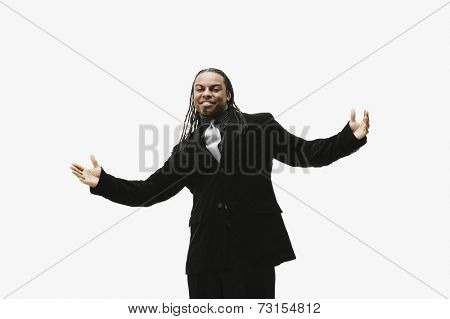 Portrait of African businessman with arms outstretched