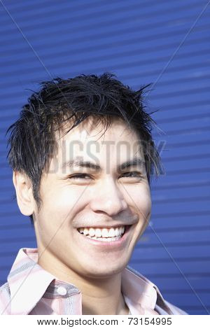 Close up of Pacific Islander man smiling