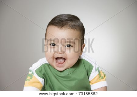 Studio shot of baby boy laughing