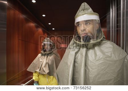 African man and woman in hazmat suits