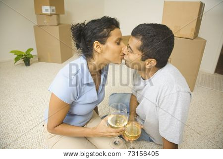 Indian couple kissing in new house