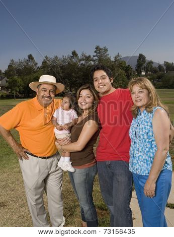 Portrait of multi-generational Hispanic family outdoors