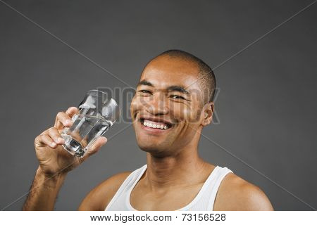 Portrait of Asian man drinking glass of water