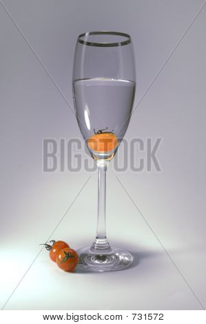 Tomato Inside The Glass In White/grey Background