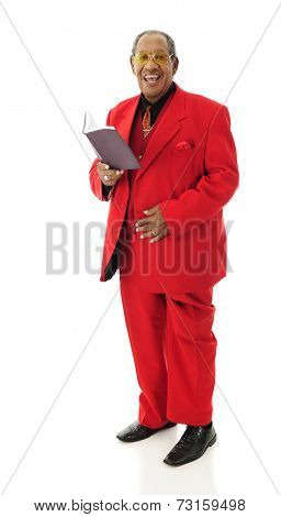 Full-length image of a singing senior man in his red, 3-piece suit.  On a white background.