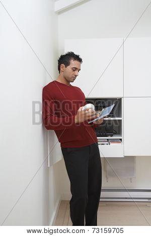 Man looking at cd case