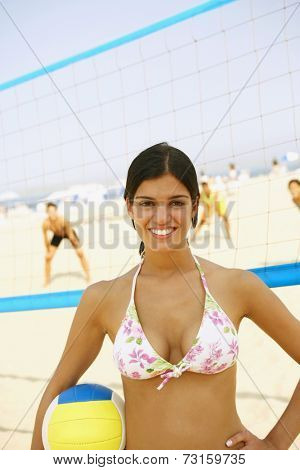Young woman holding volley ball