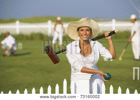 Young woman playing croquet