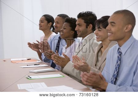 Multi-ethnic businesspeople clapping