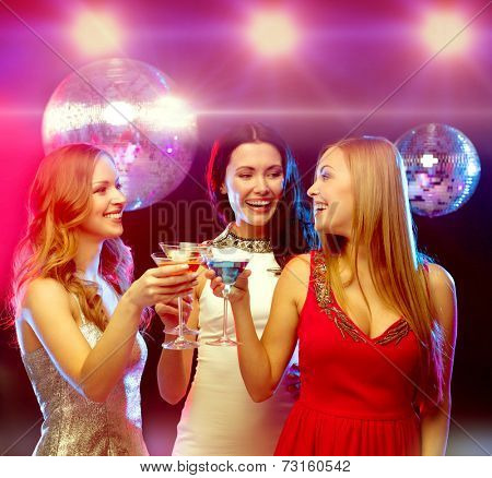 new year, celebration, friends, bachelorette party, birthday concept - three women in evening dresses with cocktails and disco ball