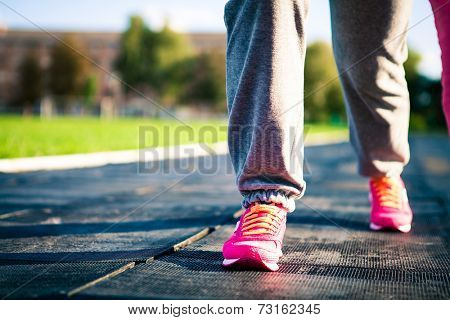 athletic pair of feet on a grass