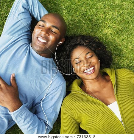African couple listening to same mp3 player